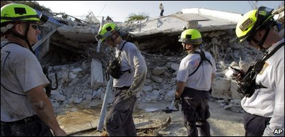 Rescue workers outside a collapsed hospital in Port-au-Prince