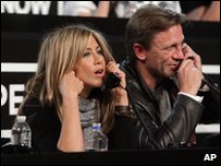 Actress Jennifer Aniston and James Bond actor Daniel Craig answering phones for Hope for Haiti Now
