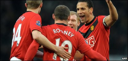 Wayne Rooney's team-mates congratulating him for scoring four goals