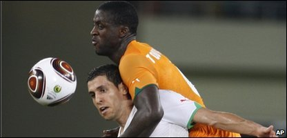 "Algeria""s Karim Matmour, left, is challenged by Ivory Coast""s Yaya Toure during their African Cup of Nations quarterfinal soccer match in Cabinda, Angola, Sunday, Jan. 24, 2010"