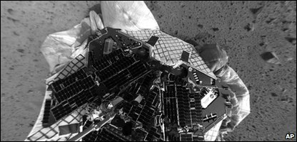 image taken by the navigation camera on the Mars Exploration Rover Spirit shows a clear overhead view of the rover on the surface of Mars