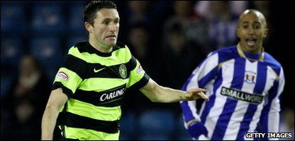 Celtic's Robbie Keane and Mehdi Taouil of Kilmarnock