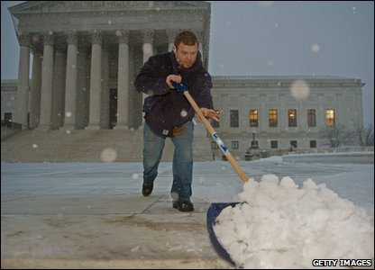 Man clearing snow