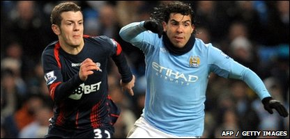 Manchester City's Argentinian forward Carlos Tevez (R) vies with Bolton Wanderers' English midfielder Jack Wilshire
