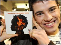 X Factor winner Joe McElderry with a copy of the Haiti single