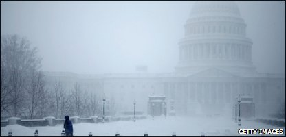 The famous Capitol Building in Washington is covered in snow