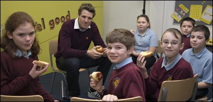 Olivia [third from left], her classmates and Olympic rowing champion James Cracknell
