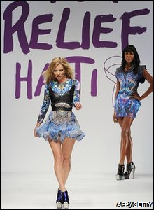 Kate Moss kicks off the catwalk fashion show in aid of Haiti relief.