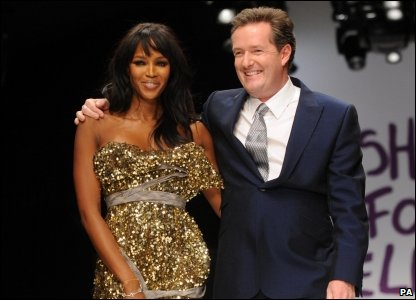 Naomi Campbell organised the event that marked the start of London Fashion Week. Here she is with Britain's Got Talent judge Piers Morgan.