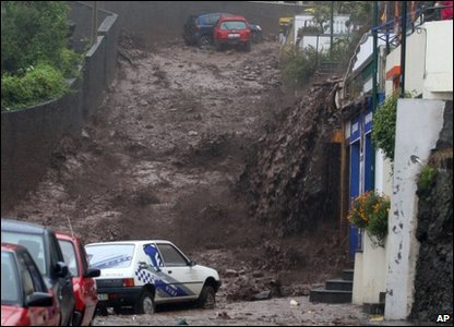 Mud and water rushing down a street in Funchal