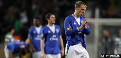 Everton's Phil Neville (right) with other disappointed team mates