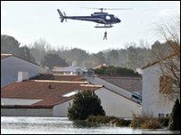 Police helicopters looking for people stranded on roofs.