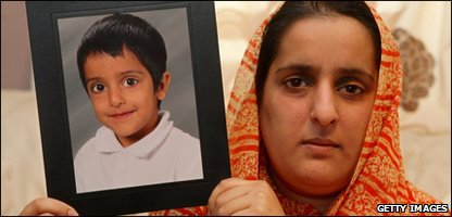Sahil's mother, Akila Naqqash, holds a photo of him