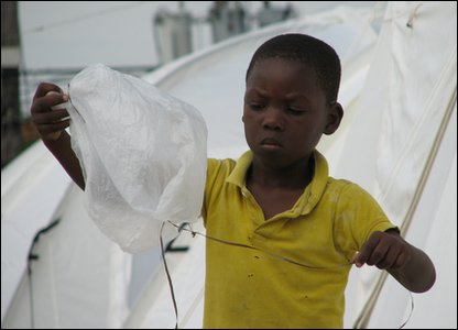 This child has even made his own balloon out of a plastic bag and a piece of string!