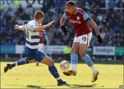 Aston Villa's John Carew, right, competes for the ball with Reading's Ivar Ingimarsson