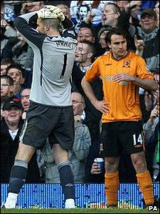 Hull City's Richard Garcia (right) stands with their goalkeeper Boaz Myhill after heading the ball into their own net