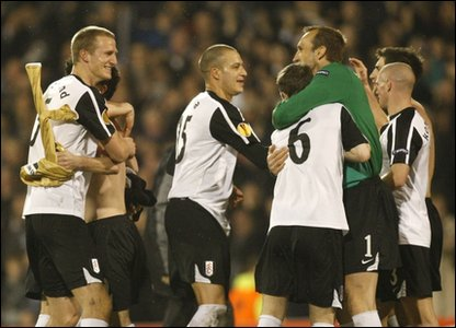 Fulham players celebrate their win