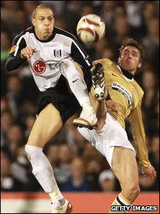 Fulham's Bobby Zamora is challenged by Zdenek Grygera of Juventus