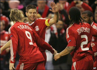 Steven Gerrard and other Liverpool players celebrate in front of fans