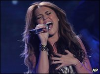 Miley performing on American Idol