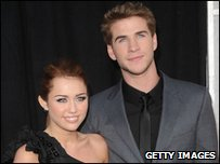 Miley with her boyfriend and co-star Liam Hemsworth