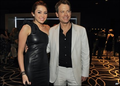 Miley with Greg Kinnear