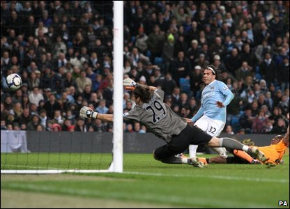Carlos Tevez scores his second goal