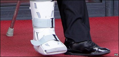Rooney on crutches
