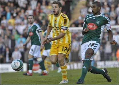 Newcastle's Alan Smith and Plymouth's Reda Johnston