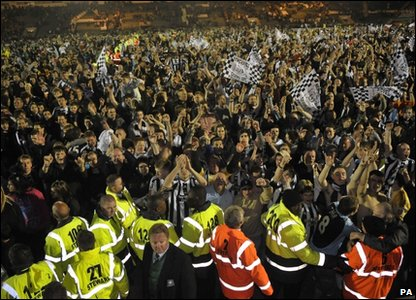 Newcastle United fans invade the pitch