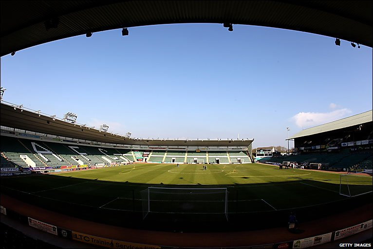 The Groundsman Mows Grass On Pitch At Home Park In Front