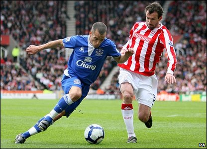 Everton's Leon Osman (left) and Stoke City's Danny Higginbotham (right
