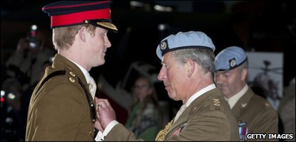 Prince Harry at the presentation with his dad, Prince Charles