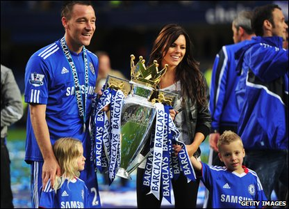 John Terry celebrates with his wife and two children.
