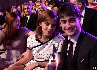 Emma Watson and Daniel Radcliffe with their award