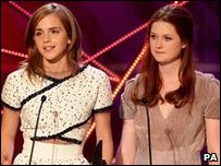 Emma Watson and Bonnie Wright accept award