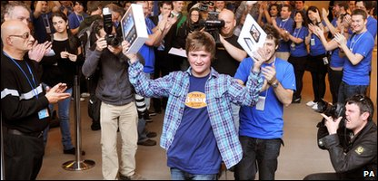 Teenager Jake from Essex, southeast England, leaves the Apple store in Regent Street, London, with his new iPad