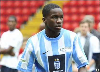 Tinchy Stryder was another of the celebs battling on the pitch for the charity cup.