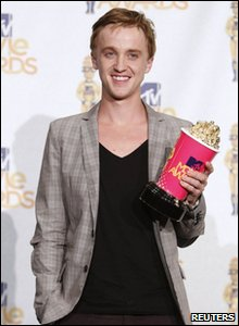 Tom Felton with his award