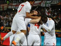 Players celebrate after captain Steven Gerrard gives England an early lead.