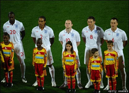 The England squad sing the national anthem just before the start of their opening World Cup match against the USA at the Royal Bafokeng Stadium in Rustenburg.