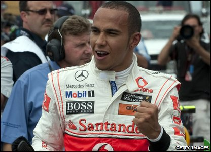 Lewis Hamilton celebrates after baggiong pole position at teh Canadian Grand Prix.