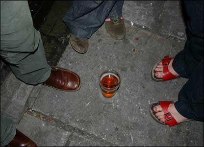 People's feet outside a bar