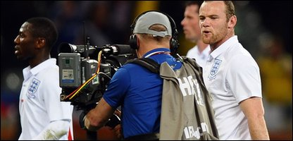 England player Wayne Rooney shows his annoyance at booing fans.