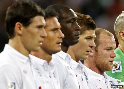 England play Algeria in their Group C match in Cape Town. The squad sings the national anthem.