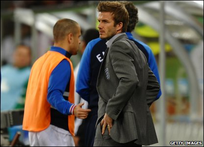 David Beckham watches the game from the stands. He doesn't look too happy either!