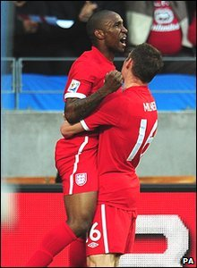 Jermain Defoe celebrates with James Milner