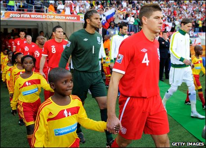 Steven Gerrard leads the England squad out