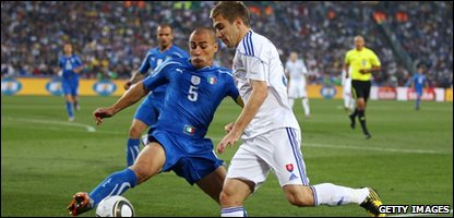 Fabio Cannavaro of Italy attempts to block the cross by Erik Jendrisek of Slovakia