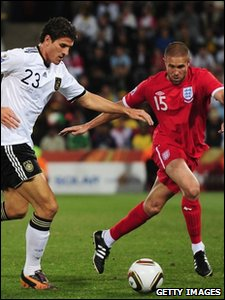 Mario Gomez of Germany is challenged by Matthew Upson